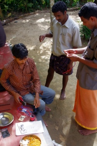 Locals actively involved. (Left to right) Madhan, Rajesh and Sudhakar working on electronics.