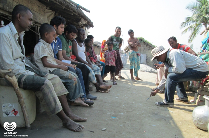 WildTeam discussing human-tiger conflicts with locals in the Sundarbans.