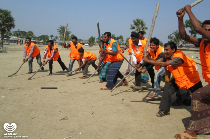 Members of the Village Tiger Response Team training to scare tigers out of villages.